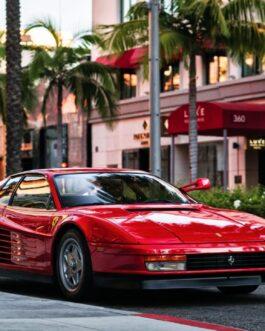Plakat Ferrari 512 Testarossa pod palmami